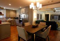 Two walls were removed to create an open space encompassing the kitchen, dining area and den space. A wet bar was removed to accommodate the wall TV installation.( Mona Reeder  -  Staff Photographer )