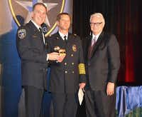 Capt. John Thorpe, center, receives the Brass Pig Award from Chief Larry Boyd, left, and Interim City Manager Steve McCullough, right, at the 18th Annual Irving Police Awards Banquet.Photo submitted by IRVING POLICE DEPARTMENT