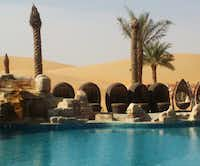 Poolside at the Arabian Nights Village hotel in the Al Khatim desert of the United Arab Emirates. The boutique hotel is small, with roughly 12 small huts and one restaurant on site for those who believe getting away means getting away from most of life.