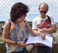 Gui Castro Felga (left) and Pedro (who would not provide his last name) co-founded the Worst Tour in Porto, Portugal last year. The 30-something, unemployed architects say the name of the tour is a joke, and they are not anti-tourism. The tour takes visitors outside the tourist hubs, and guides offer a history lesson and political discussion along the way.( Erica Sweeney )