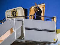 President Obama disembarks from Air Force One. (Ashley Landis/Staff Photographer)