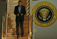 President Obama walks down the stairs of Air Force One upon his arrival at Dallas Love Field. (Jae S. Lee/Staff Photographer)
