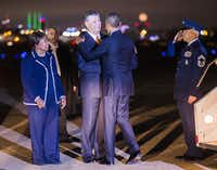 President Obama greets Dallas Mayor Mike Rawlings and U.S. Rep. Eddie Bernice Johnson as he arrives in Dallas. (Ashley Landis/Staff Photographer)