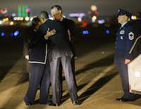 President Obama greets U.S. Rep. Eddie Bernice Johnson and Dallas Mayor Mike Rawlings. (Ashley Landis/Staff Photographer)
