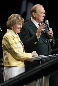 """James Dobson, host of Family Talk Radio, and his wife, Shirley, greet the crowd during  """"The Response"""" on Saturday."""