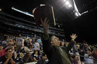 "Pastor Julio Barquero of Pasadena raises his arms in prayer during ""The Response"" on Saturday at Reliant Stadium in Houston."
