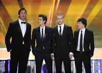 """The cast of """"The Social Network"""" from left, Armie Hammer, Andrew Garfield, Justin Timberlake and Jesse Eisenberg are seen on stage at the 17th Annual Screen Actors Guild Awards on Jan. 30, 2011 in Los Angeles."""