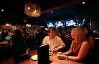 Ben and Blair Huddleston talk at one of the tables at Primebar.