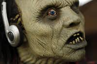 A monster mask sports headphones at the home of Ralph Granado Friday, September 28, 2012 in Dallas.