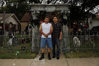 A passion for Halloween decorations runs in the family of Ralph Granado (left) and son, Derrick.