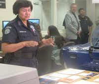 Sheriff Lupe Valdez displayed the sort of products that the print shop will sell to county businesses. She said the shop will be sulf-sufficient.