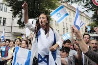 Pro-Israel demonstrators shouted slogans at a pro-Palestinian rally in Berlin on Friday. The protests passed without violence despite growing concern over anti-Semitic rhetoric at rallies in Germany and elsewhere in Europe.Markus Schreiber - The Associated Press