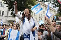 Pro-Israel demonstrators shouted slogans at a pro-Palestinian rally in Berlin on Friday. The protests passed without violence despite growing concern over anti-Semitic rhetoric at rallies in Germany and elsewhere in Europe.(Markus Schreiber - The Associated Press)