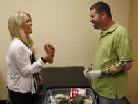 "Lauren Scruggs, with fellow amputee Jason Koger of Owensboro, Ky., has discovered a deepened joy since her accident. ""There's a light to her,"" her physical therapist said."