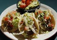 Jacala's puffies are smaller, easily consumed in two to three bites. They share a chewy mouth feel with Henry's version. Although officially the order is a platter of three tacos of the same filling, it doesn't hurt to ask if you would like the plate customized.(Vernon Bryant - Staff Photographer)