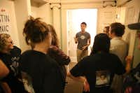 Stefan talks to a group in the waiting area at Austin Panic Room.( Thalia Juarez  -  Reporting Texas )