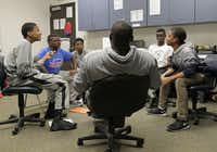 Cobb Middle School coach Lamont Finley poses questions about African-American inventors, CEOs, scientists and authors to students (from left) Drew Murray,  Benjamin Washington,  Jared Sanders, Cameron Miller and Jeremy Kennard.(Vernon Bryant - Staff Photographer)