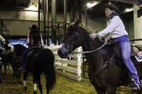 Cathy Grant pats her horse before their barrel-racing run at the Fort Worth Stock Show & Rodeo.