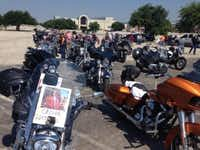 Several bikers posted signs on their motorcycles to protest the 143 people still jailed in Waco. (Vernon Bryant / The Dallas Morning News)