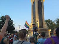 Daniel Cates, one of the organizers of the rally, speaks to the crowd at the Legacy of Love Monument at Oak Lawn Avenue and Cedar Springs Road.