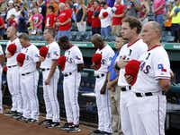 Josh Hamilton (second from right) and Rangers teammates and fans observed a moment of silence for fan Shannon Stone, who died when he fell from the stands during Thursday night's game.