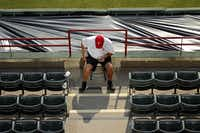 A Rangers event staff employee was stationed in the aisle at Rangers Ballpark on Friday.