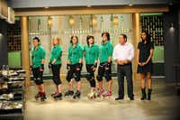 "The Rat City Rollergirls are ""one of the hottest sports teams in Seattle,"" and they were the subject of the elimination challenge this week on ""Top Chef: Seattle."" They're seen here with Emeril Lagasse and Padma Lakshmi.(David Moir - Bravo)"