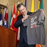 Dallas Mayor Mike Rawlings showed off the official shirt during his announcment detailing the Men Against Abuse rally that will be held on Saturday.