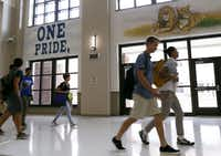 Students make their way to their next class during the first day of class at Reedy High School in Frisco, on Monday, August 24, 2015.