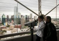 Amber Torres, 11, and her father, Gilbert, take in the view of downtown Dallas from the observation deck at Reunion Tower, known as the GeO-Deck.