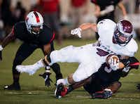 Rowlett running back Anthony Wagner is tackled by two Lake Highlands players in last week's 30-22 victory.