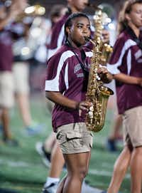 A Rowlett saxophonist performs during a game against North Mesquite in August. Rowlett was defeated 36 to 27.