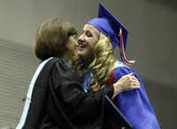 J.J. Pearce graduate Victoria Lane Hoffmeister hugs Principal Beverly Vance after receiving her diploma.