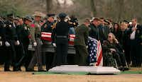 Pallbearers carried Officer Hawkins' casket to his the gravesite at Oak Grove Memorial Gardens in Irving on Dec. 28, 2000.