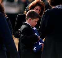 Officer Hawkins' son, Andrew Wright Hawkins, clutched a folded U.S. flag during the graveside service.