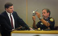 Toby Shook, lead prosecutor in the George Rivas murder trial, listened to Irving police Crime Scene Officer Steven Hazard describes a gun found at the scene of a police shooting on Aug. 14, 2001.