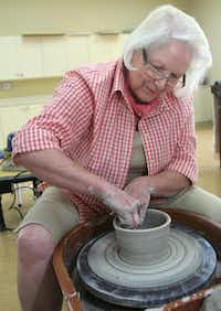 Jo Ann Hanes throws clay at Robson Ranch.