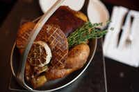 At Rôtisserie Georgette, poule de luxe consists of roasted chicken with bread crumbs and mushrooms stuffed under the skin, and slabs of seared foie gras atop.Melanie Burford  -  Special Contributor