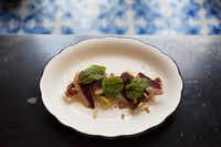 A serving of roasted leeks with duck prosciutto, mache, pignoli and grilled red onion vinaigrette is photographed in front of the signature blue-and-white Portuguese tile of Rôtisserie Georgette.Melanie Burford  -  Special Contributor