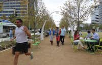 """Klyde Warren Park is still popular after last month's opening.  """"We don't want to be over-confident. … But we see attendance as very strong,"""" said Mark Banta, park president. More food trucks and carts have been added after visitors said there were too few choices, Banta said."""