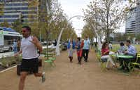 "Klyde Warren Park is still popular after last month's opening.  ""We don't want to be over-confident. … But we see attendance as very strong,"" said Mark Banta, park president. More food trucks and carts have been added after visitors said there were too few choices, Banta said."