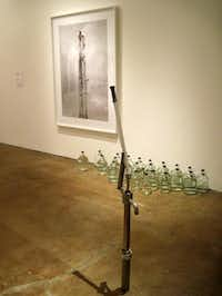 Inigo Manglano-Ovalle, Well (stainless steel, brass, glass, water, archival pigment print) at Site Santa Fe( Scott Cantrell  -  Staff )
