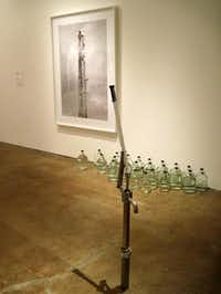 Inigo Manglano-Ovalle, Well (stainless steel, brass, glass, water, archival pigment print) at Site Santa FeScott Cantrell  -  Staff