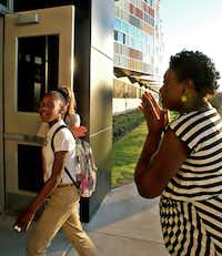 LaTasha Lewis teared up as she watched her daughter Brentavia, 12, head off to her first day as a seventh-grader at Billy Earl Dade Middle School on Monday.