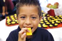 Gabriel Padron samples a piece of mango with his classmates at Brandenburg Elementary School. Brandenburg was one of many Irving ISD schools that tried mango at lunch for the first time. The program targets low-income students who may not get the nutrition they need at home.
