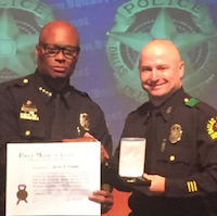 Chief David Brown gave Sgt. Jason Scoggins  the police medal of valor. (Provided by Chris Livingston)