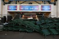Seats filled areas under the stands on Tuesday as the Texas Rangers worked to add a third row of home plate seats at their Arlington ballpark.