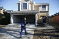 Pedro walks up to the rental house, which the family moved into on Friday. The Salazars' insurance company is covering the expense of renting the house and its furnishings.( Nathan Hunsinger  -  Staff Photographer )