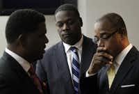 Dallas County District Attorney Craig Watkins (center) and attorneys Heath Harris (left) and Scottie Allen conferred Monday before leaving the courtroom.
