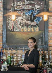 Customers were quick to appreciate the effort Tania Lazarus put into her cocktail-themed chalk images at the Standard Pour.( Rex C. Curry  -  Special Contributor )